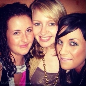 me and 2 of my friends on a night out, all smiling at the camera. We would have been about 18